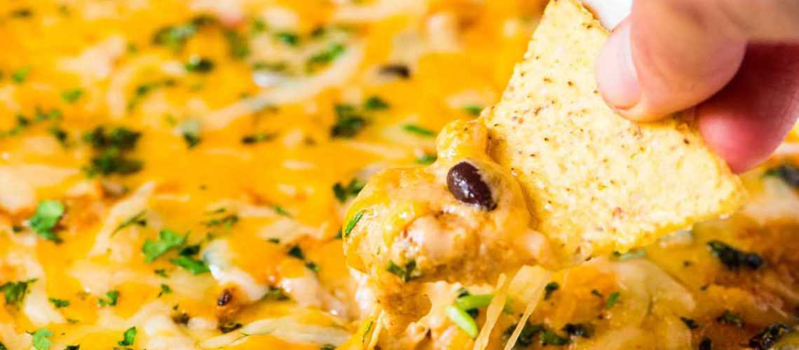 Get Ready For Game Day With Some Cheesy Chicken Enchilada Dip!